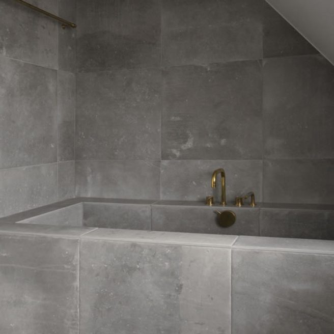 bathtub covering with stone look tiles